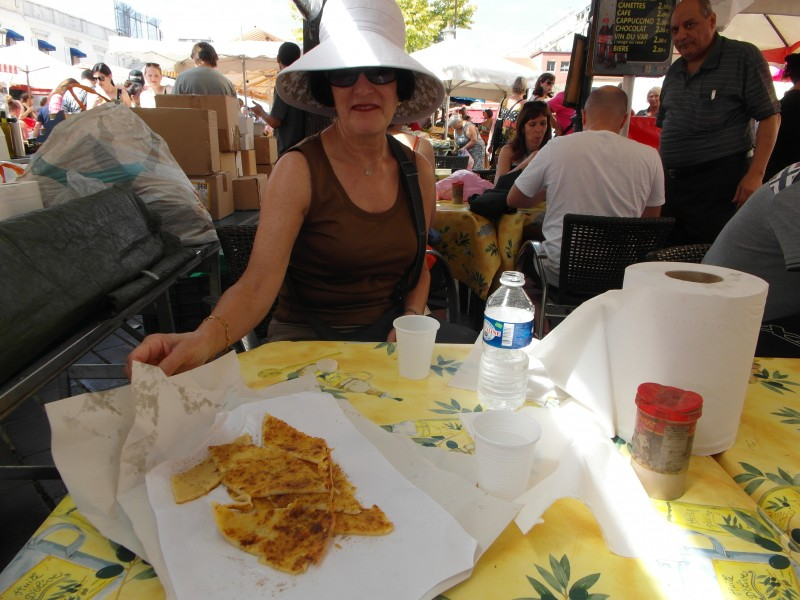 Enjoying socca at the Marche aux Fleurs (Flower Market) in Cours Saleya, Nice.