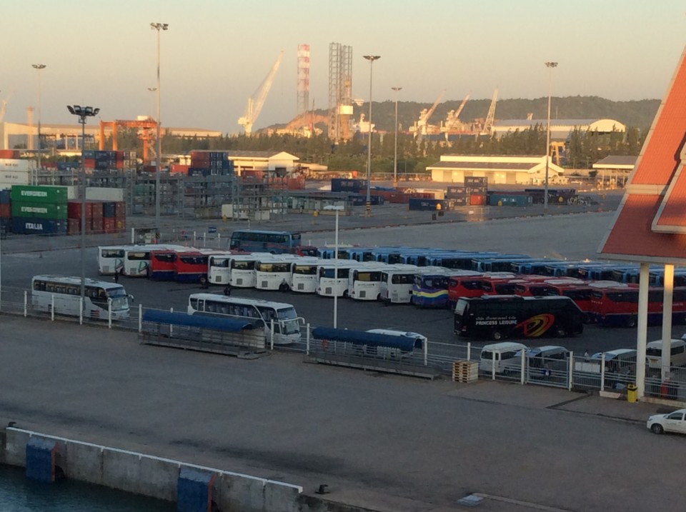 A fleet of buses in container port of Laem Chabang waiting to bus cruise ship passengers to and from Bangkok