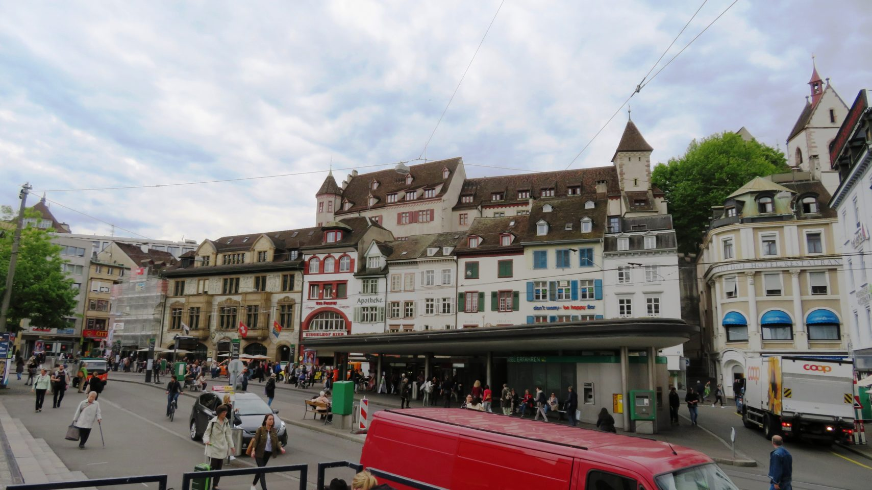 Busy historic BarfusserPlatz in <em><strong>Basel</strong></em>, Switzerland