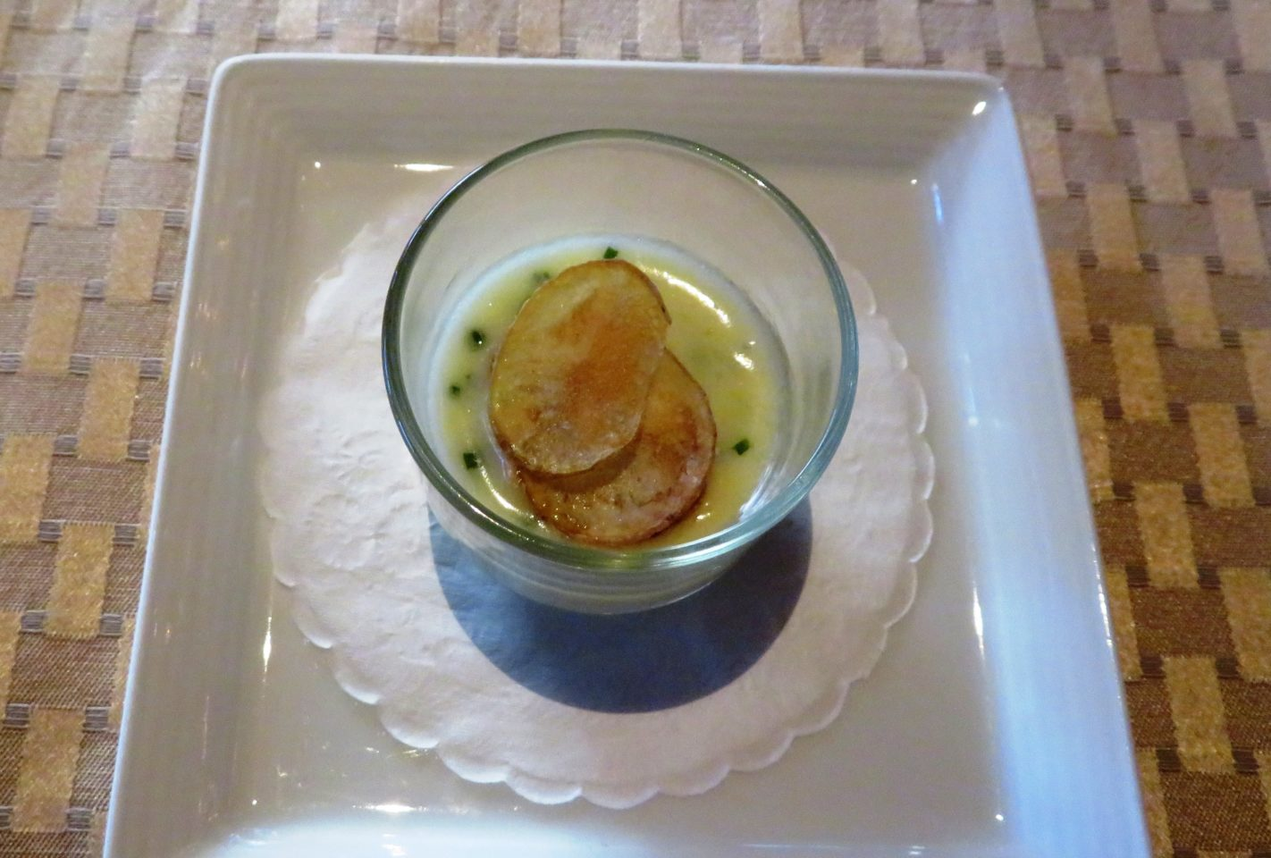 potato custard with chives to embolden the dish and home-made potato chips
