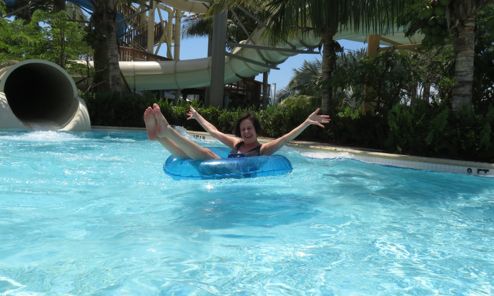 Down the 3-story waterslide into the Lazy River ~ Gem of a Florida Resort