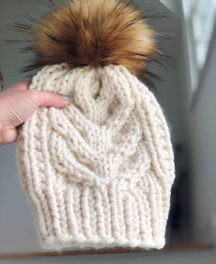 Free cable hat knitting pattern using Lion Brands wool-ease thick and quick