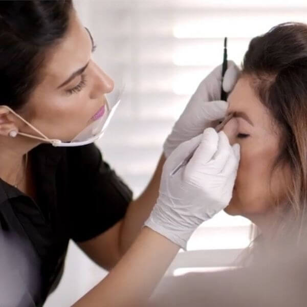 Image of Marisa and a client at Trucco Skin.