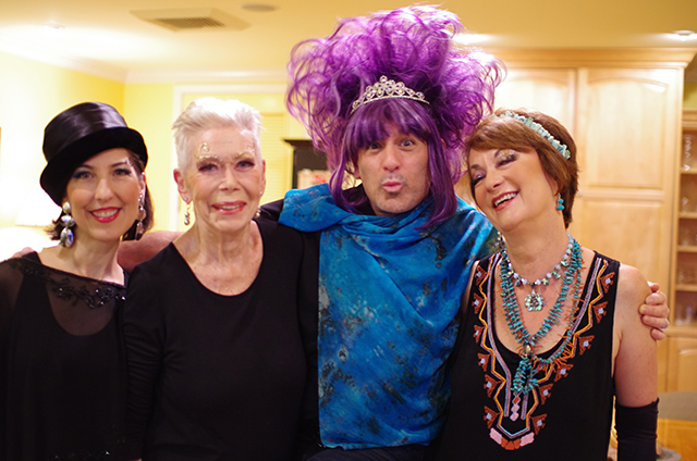 Halloween 2014. Louise decides to do it up with makeup and costumes. Daniel Peralta tries on a purple wig and acrylic high heels.