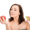 Woman Choosing Apple over Sandwich