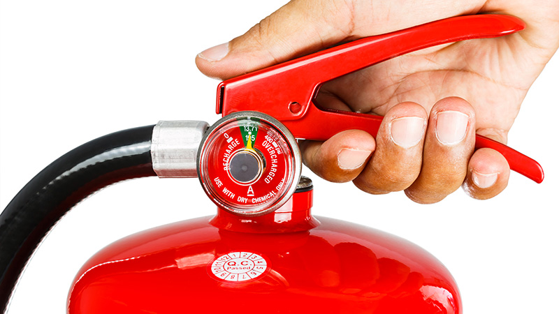 Ready to Pull Pin on Fire Extinguisher