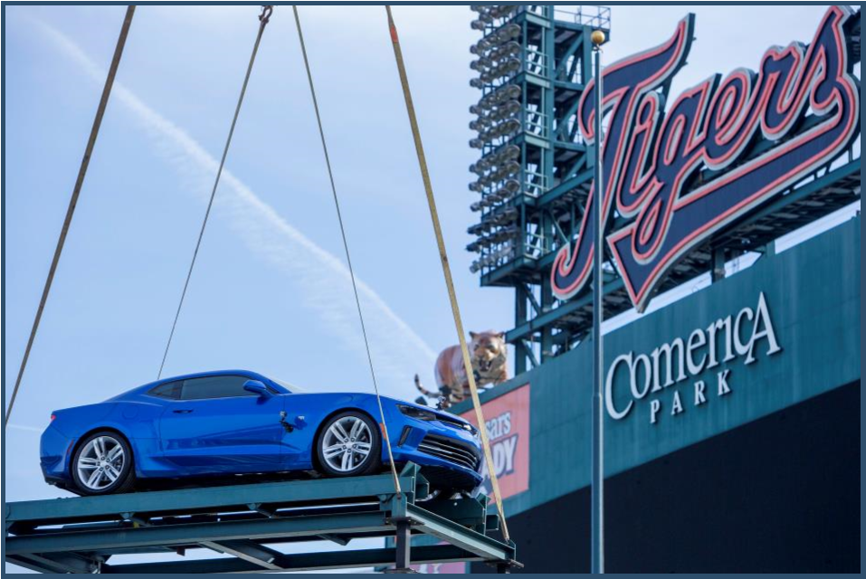 A Hyper Blue Metallic Chevrolet Camaro SS is loaded by crane onto the top of the Chevrolet Fountain inside Comerica Park, home of the Detroit Tigers, in time for the start of the baseball season Wednesday, March 30, 2016. The Tigers' home opener is Friday, April 8 against the New York Yankees.