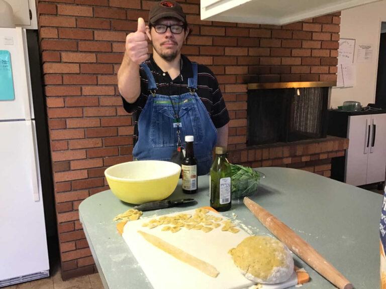 Resident making pasta