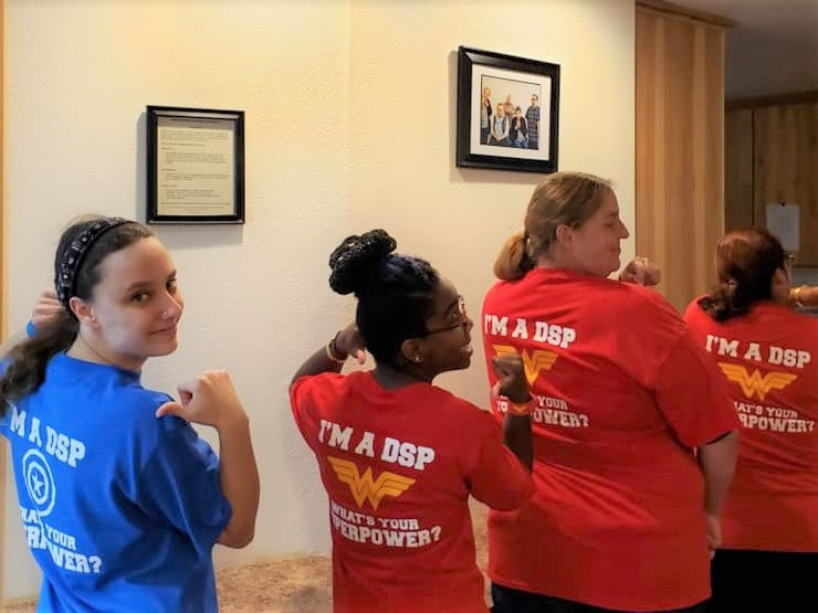 Staff members wearing DSP t-shirts