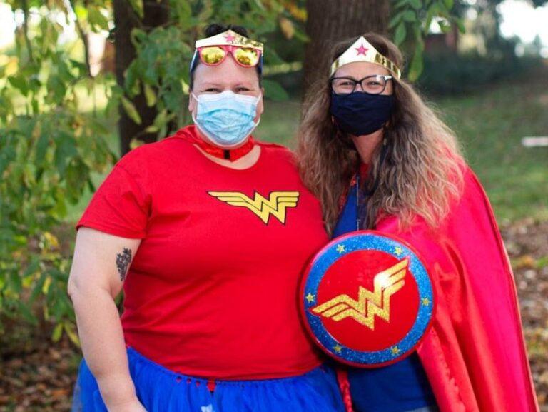Two women in super hero costumes
