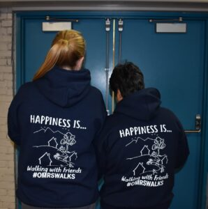 Staff members wearing happiness is OMRS shirts
