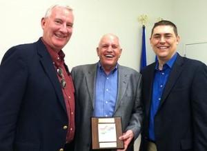 Warren Wimmer, John Monahan, and Terry Goddard II celebrate the Paul Starke Awards.