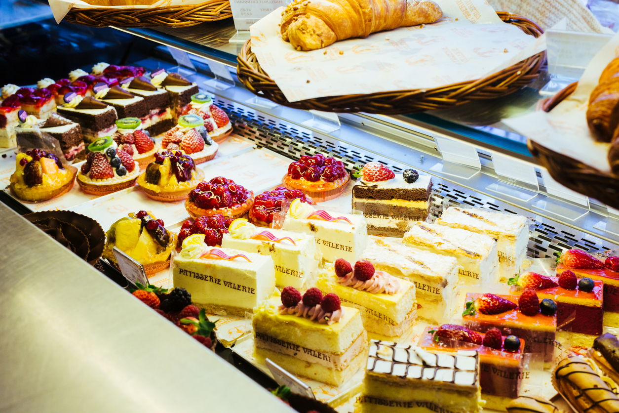 Close up photo of the showcase with cakes in Patisserie Valerie