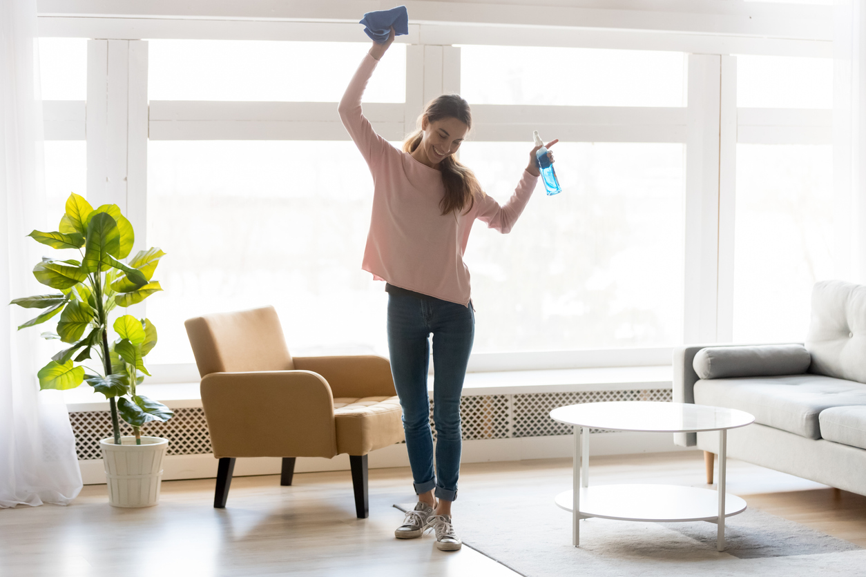 a women cleaning her house while dancing