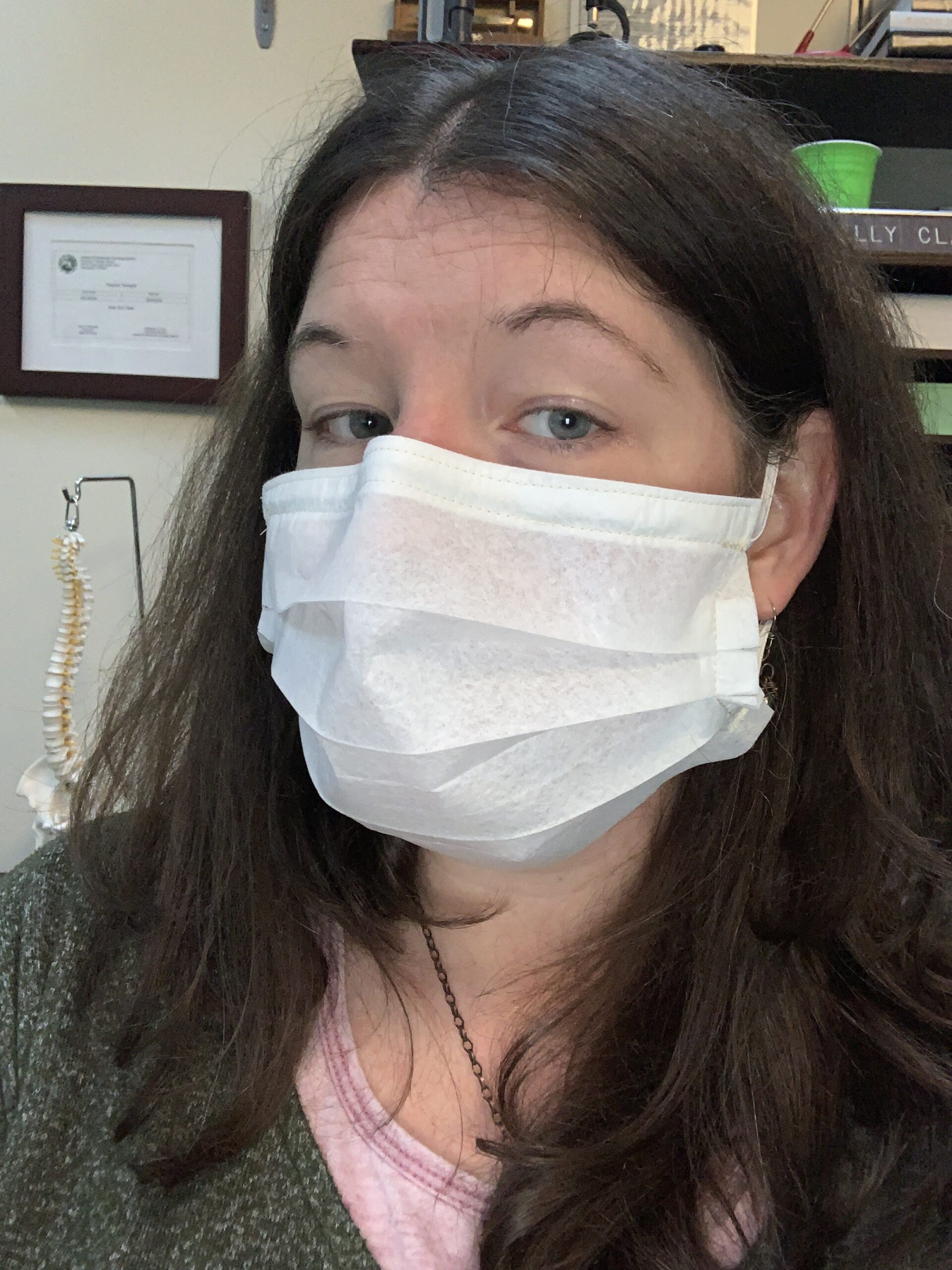 Photo of Dr. Kelly Clark wearing a fabric facemask