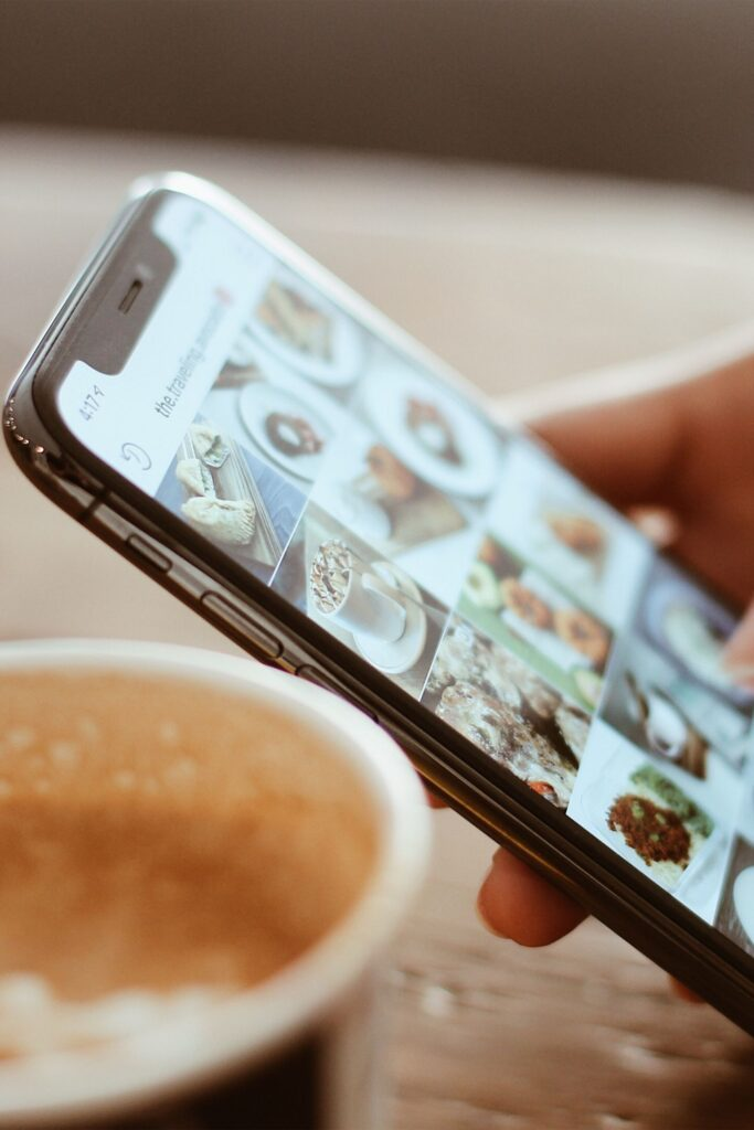instagram feed on a smart phone and a coffee