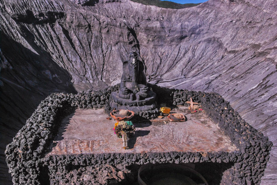 Hindu God Ganesha , on the rim of the Bromo crater, protecting the people from the volcano