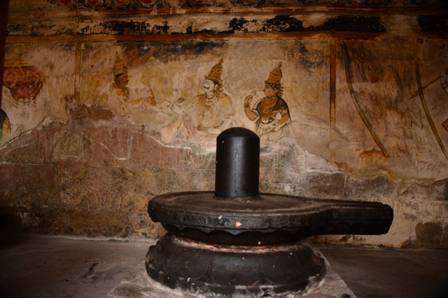 Chola paintings in a dilapidated condition with the lingam in the front.
