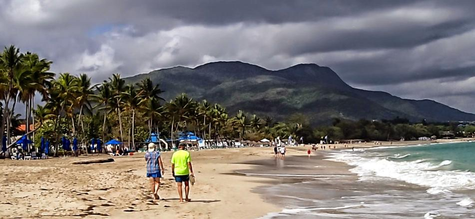 Playa Dorada Beach with its Golden sands and mountains on both sides