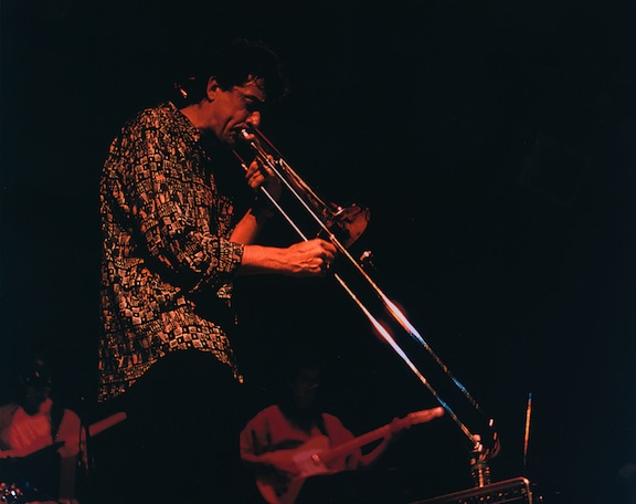 Michael Davis playing his trombone in live concert.
