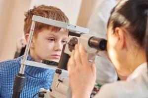 Child Having Eye Exam Inside Mobile Optometry Unit