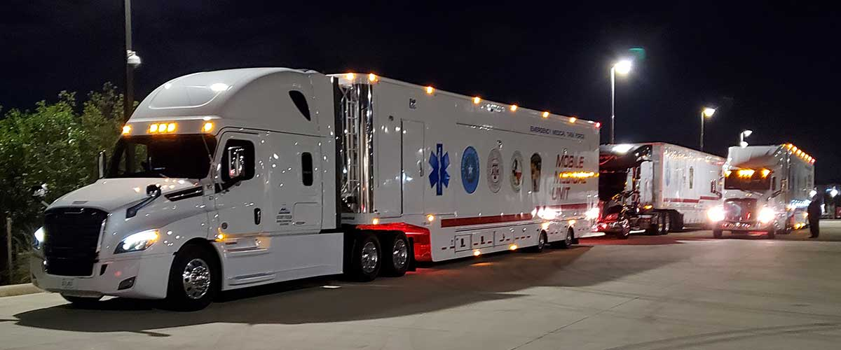 Photo Texas Emergency Covid  Mobile Icu Facility Night View Of All Four Trucks