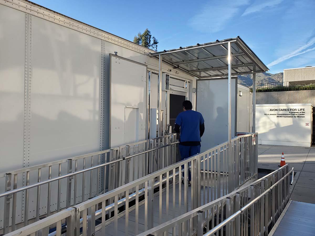 Photo La County Mobile Compounding Pharmacy Outside Man On Ramp