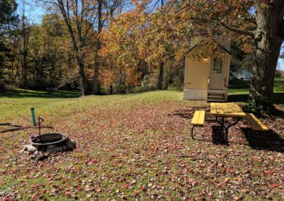 New River Tiny House hotel fire ring and picnic table