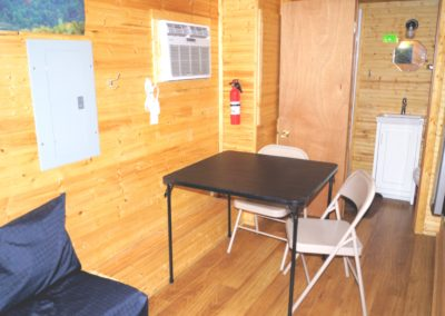 New River Tiny House hotel first floor of tiny house with table & chairs