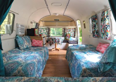 Airstream located at New River Gorge Campground looking to front at 2 twins on sides