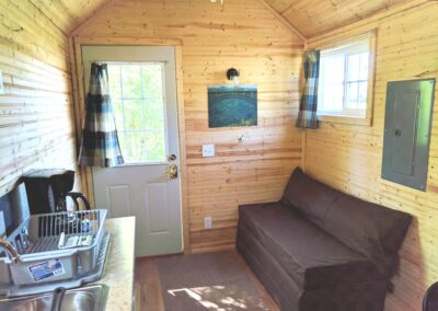 New River Tiny House hotel first floor of tiny house couch turns into bed