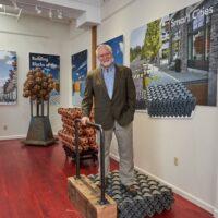 Sam standing on sidewalk model in gallery (3)