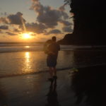 playa ventanas sunset dad holding baby
