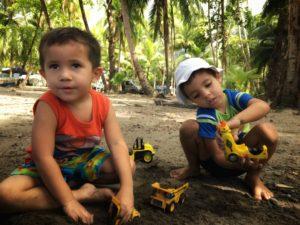 two boys playing in sand playa ventanas costa rica