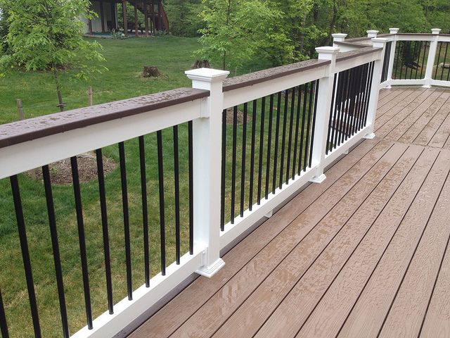 Deck railing repair with vinyl and aluminum Railing. Deck upgrade by Houston Remodeling Services.