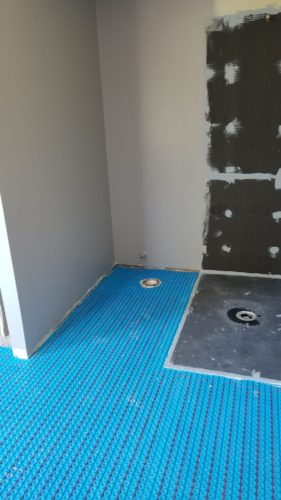 Curbless Wedi shower system with heated surrounding floor