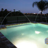 Pool at Night with Large Water Fountains