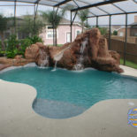 Large Rock Formation with Slde and Pool