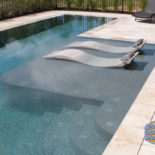 Very Unique Pool with Lay In Chairs