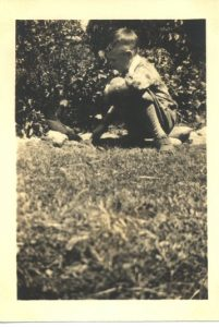 Irving Petite, 1931, feeding two wild birds.