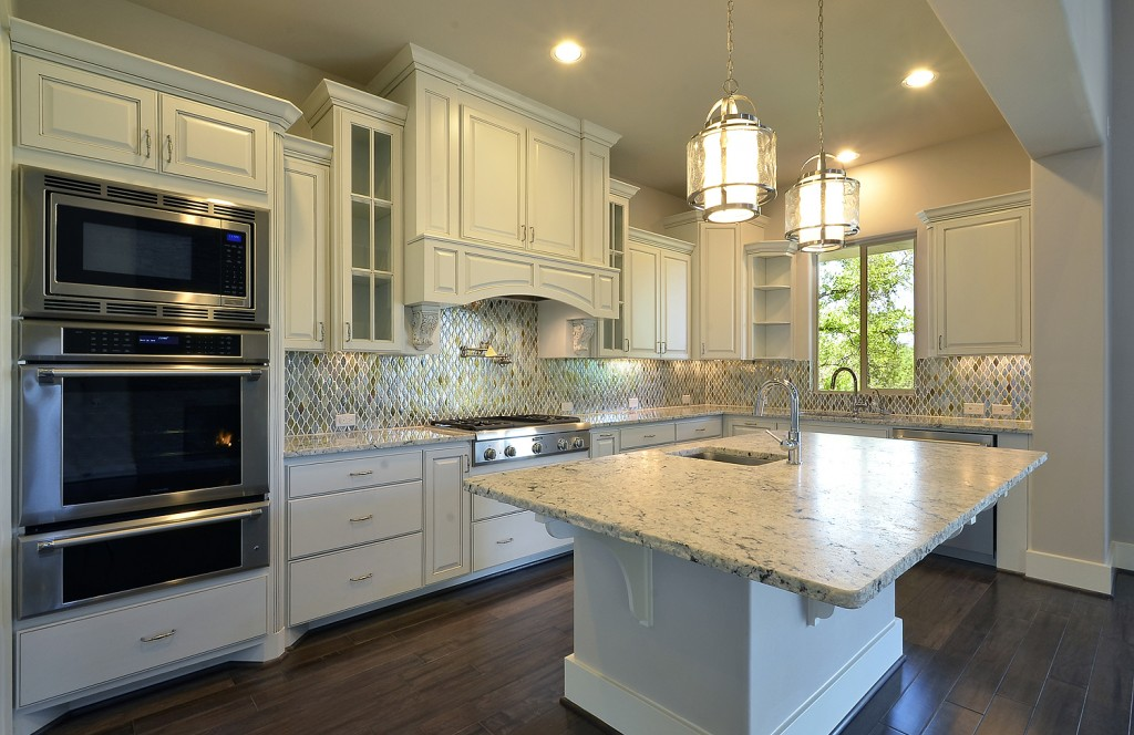 Burrows Cabinets white kitchen with Elite vent hood