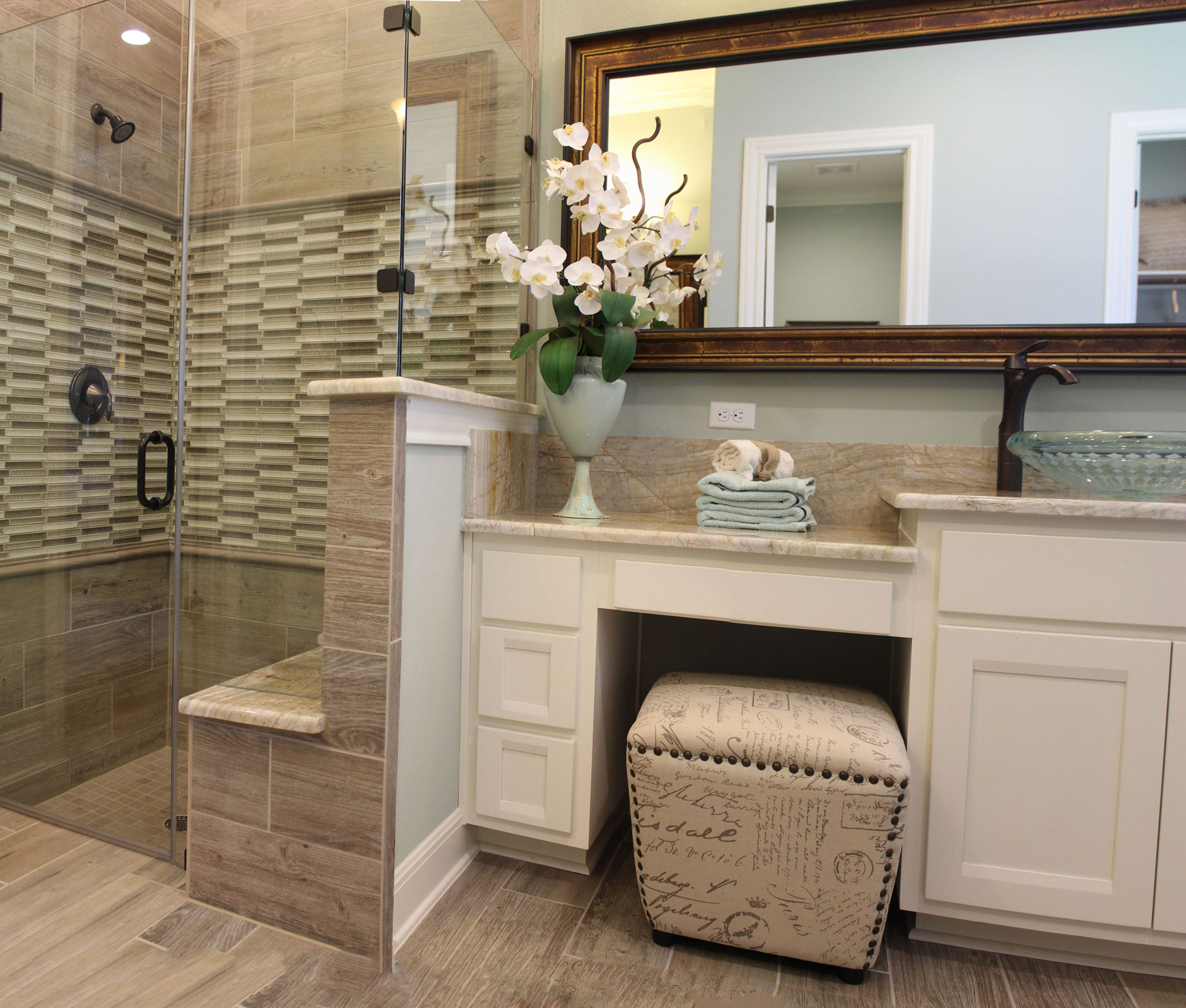 Burrows Cabinets' master bath cabinets in Bone with Briscoe doors and knee space