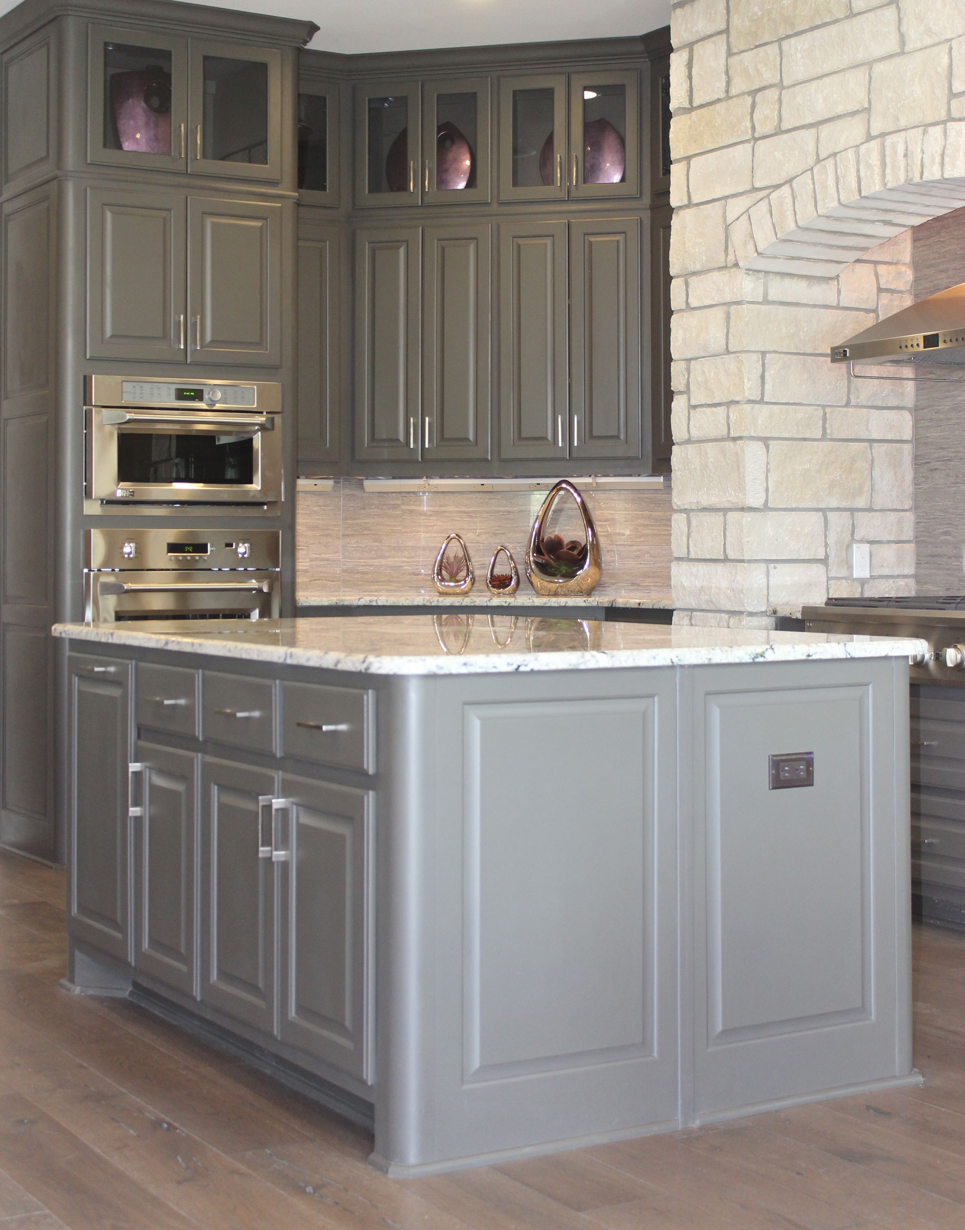 Kitchen island in Umber with integrated corners by Burrows Cabinets