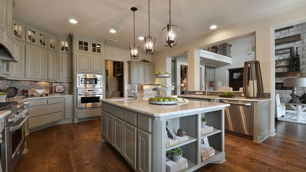 Burrows Cabinets kitchen island with bookshelves and integrated corners in Ecru