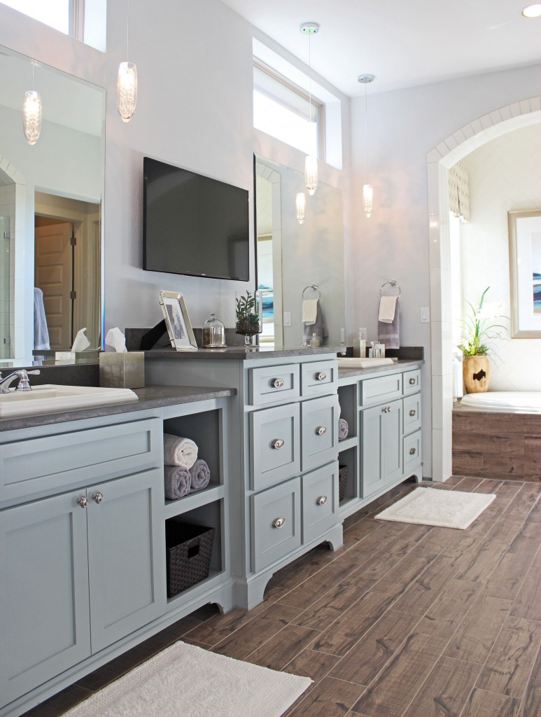 Burrows Cabinets shaker style primary bath cabinets with open shelves and bumped up drawer stacks