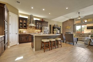 Burrows Cabinet's kitchen in Beech with Kona stain and glass upper cabinet doors