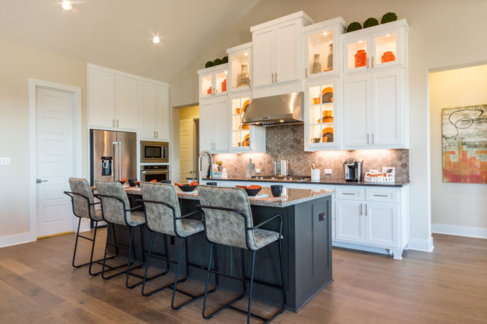 Burrows Cabinets' kitchen in Bone white with Umber grey island