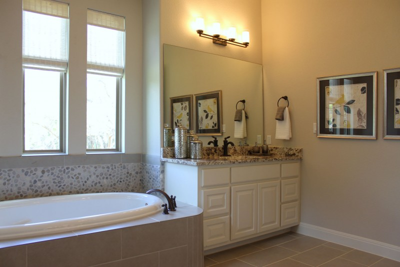 Burrows Cabinets master bath vanity cabinets in Bone
