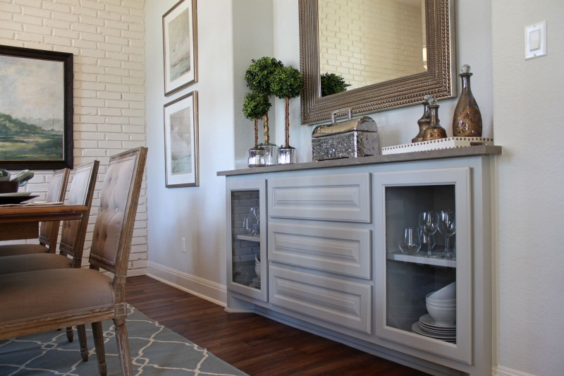 Burrows Cabinets built-in buffet cabinet painted gray with cabinet doors cut for glass inserts