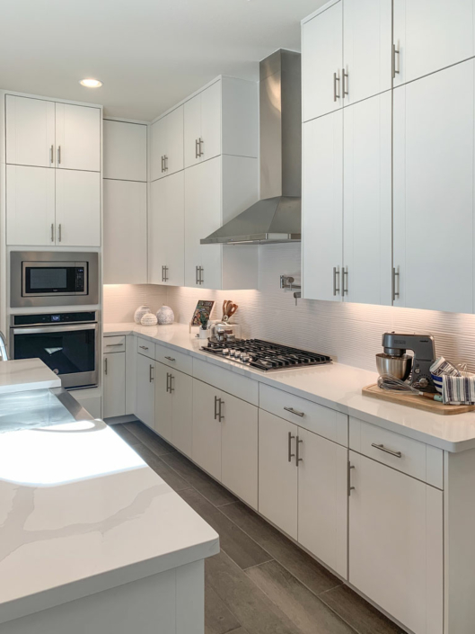 Kitchen interior view in EVRGRN Luxe textured white with 3-piece doors
